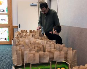 father and son packing lunches