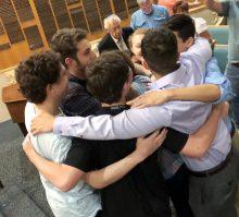 teens in a group hug