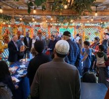 people gathered in a sukkah