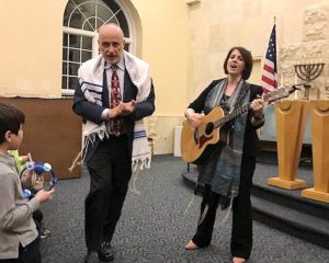 rabbi and cantor leading a service