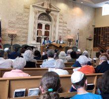 rabbi and cantor leading shabbat service