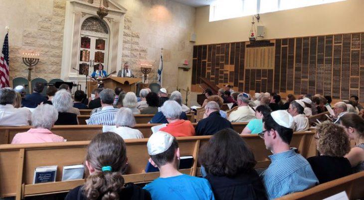 rabbi cantor leading service on the bimah