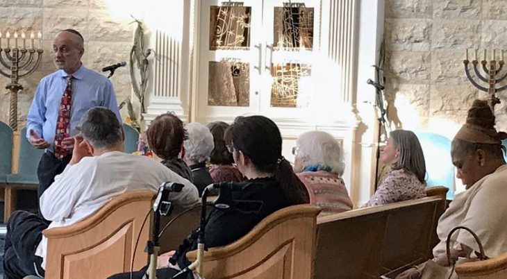 rabbi teaching to congregants seated in pews