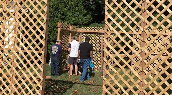 congregants building a wood lattice sukkah