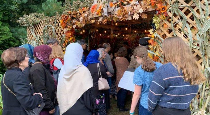interfaith gathering in a sukkah