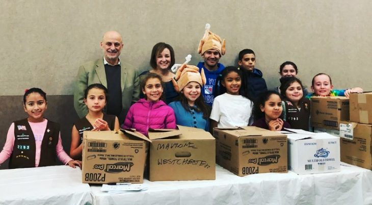 rabbi with children packing food boxes